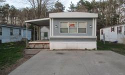 mobile home with shed for sale in buchanan ,has alot of updates,..one bathroom,3 bedrooms,lot rent is $295 and $9 for trash,water is included, new floors throughout, new kitchen,new bathroom, newer fu