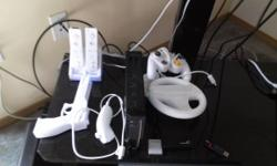 The Ultimate Package Selling my black modded Wii Comes with all Cords and Sensor Bar 2 Controllers 1 Nunchuck Recharging station with 2 Rechargeable Packs 1 Mario Steering Wheel 1 Wii Gun 1 500 GB Ext