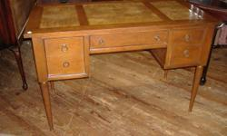 130115.   We are selling a beautiful Danish contemporary walnut writing or computerdesk from the 1960's -1970's.   Taperedlegs sustain the whole of this piece. The streamlined, basic, lines of this wo