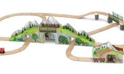 Closing our Omaha Toy and Game store. New in original box. Wooden train set includes a two-level mountain bridge and three cool train tunnels! Over 60 pieces of track and accessories combine for a var