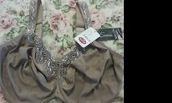A never worn before, high quality, full support, beige-brown elegant bra, size I64. Couldn't return it in time. Emma Lingerie is a French Canadian boutique that specializes in bigger women lingerie.