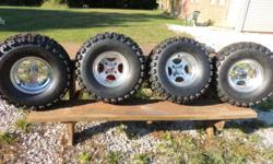 New EZGO Golf cart Tires & Rims, got as a gift and never on a machine, will fit ezgo carts and more with lift kits $550 OBO Phone Chuck at 440-668-5030 or 440-272-5389