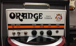 The 15W Orange Amplifiers Tiny Terror TT15 Mini guitar amp head provides mobility in an all-tube amp. The TT15 Tiny Terror boasts a 2-stage preamp that has a large tonal range using simply 3 controls.