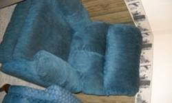This is a nice small recliner in medium blue fabric. No rips, stains, etc. Call 218-829-0523 Location: Baxter