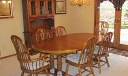 "This posting is for a wonderful oak table which has 2 leaves and is very sturdy.  There are 6 chairs .... two of which are captains.  Table dimensions are:  46"" wide x 47"" long (without leaves)  Each"