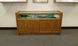 I have several solid oak/ glass displays they range in size used to display merchandise the corner displays have 2 sliding doors, the larger ones have storage space underneath Will negotiate   I also