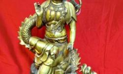 Guan Yin is the bodhisattva of compassion and wisdom in Chinese Buddhism. She is highly revered. Her name means 'She Who Hears the Cries of the Whole World. This old bronze Gwan Yin sitting on the dragon is unusual position, with all fine detailed and