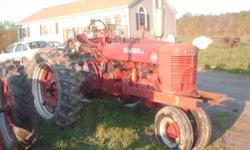 2 antique tractors, 1 farmall M, great running powerful tractor with excellent rubber and in nice shape. Rare hand clutch that will allow you to disengage the rear wheels while leaving the PTO running