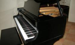 """5'7"""" Diapason (made by Kawai) parlor grand piano in gleaming polished ebony. Purchased new from R. Kassman in 1987. """"Diapason"""" is a name Kawai used on pianos that were primarily being sold in Europe."""