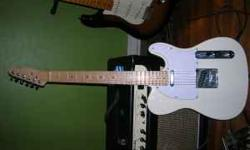 This is probably a kit guitar from China. It would be a good Tele for some upgrades and whatnot. Neck is unfinished but straight. Body has some nice aged paint with a few nicks and stuff. It also has