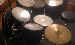 I'm selling an 8-piece PDP drum set. There are 2 bass drums, 3 rack toms and 2 floor toms with a snare drum. All of the hardware is included, as well as a set of high hats, ride cymbal and crash cymba