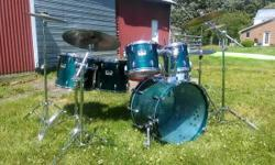 """Pearl Session $350 - 22"""" bass, 10"""", 12"""" rack toms; 14 and 16"""" stand mounted floor toms; 13"""" Pearl steel snare drum. Complete is rough but drums are otherwise in excellent shape, sound terrific, and tu"""