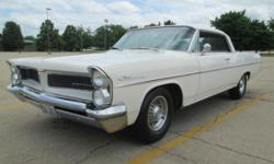 1963 Pontiac Catalina 2 door hardtop. This 63 Catalina has 389 with a tri-power, the engine is clean and runs good. It is connected to a automatic transmission. The car has factory air conditioning, i