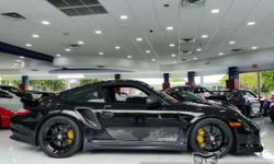 This 2011 Porsche 911 2dr GT2 RS Coupe features a 3.6L FLAT 6 CYLINDER 6cyl Gasoline engine. It is equipped with a 6 Speed Manual transmission. The vehicle is Black with a Black Leather/Suede interior
