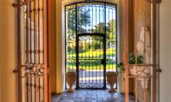 This exquisite Spruce Creek Fly-In Bella Vista estate has all the hallmarks of quality throughout, including home automation and home video surveillance system. Iron entry gates, spectacular paver pat