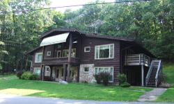 R60 AL, Chalet #1, 10 room, 6 bedroom, 7 bath. 2 lots, one of the 4 original chalets, 3902 square feet. Well established rental within walking distance of lodge, includes parking area across the road, no building lots in back. Downstairs living room