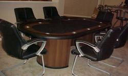 """All in Excellent Condition. This is a huge 96"""" racetrack style poker table with 9 stainless steel cup holders, built in chip rack, custom cover and has 6 leather lumbar chairs for excellent comfort. T"""