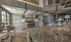 Rare riverside location adjoining to open space. This home has been exquisitely remodeled with a gourmet kitchen, hand hewn post and beam accents, custom tile and granite and designer furnishings. Thi