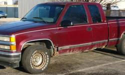 A 1995 Chevy expanded cab 2wd vehicle. This has a running 350 5.7 engine and automatic transmission. The radiator is dripping. The truck is corroded, but it does drive and run. The speedometer reveals