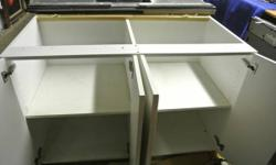 We have a variety of Builder Surplus and remodelling salvaged items for sale.  - Large Kitchen Island or Laundry Base Cabinet.  White Formica Clad Base Cabinet.  New - never been used. Unwrapped for p