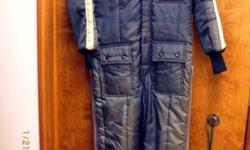 CHILLER KILLER BY SAFTBAK SNOW SKI SUIT ONE PIECE... BLACK WITH ORANGE REFLECTIVE STRIP DOWN SLEEVES... ATTACHABLE HOOD...ATTACHABLE BELT...LOTS OF POCKETS, TWO-WAY FRONT FULL ZIPPER AND SNAP CLOSURE,