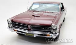 1965 Pontiac GTO finished in Burgundy over Black interior. This iconic American Muscle Car has been restored inside and out back to its like-original condition! Finished in the OEM correct Burgundy re