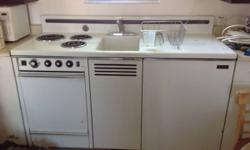 """Retro kitchen with sink, stove, oven, and fridge. $425. 5' broad, 3' tall, 2' deep, backsplash 6"""".  We have another one that needs electrical work for $350.  The Big House. 427 E. Pine ST. Central Poi"""