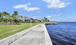 Beautiful Riverfront Home with coveted South Exposure on Royal Palm tree lined street. Fabulous wide river views await from almost every room. Second story, completed in 2014 added an exquisite second