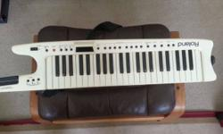 Roland AX-7 MIDI Controller Keyboard in very good +condition with only very minor wear from normal play. Excellent operating condition. Includes power adapter and 2 straps. The Roland AX-7 Strap On MI
