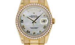 Rolex Oyster Perpetual Day-Date Watch. 36mm 18K yellow gold case, bezel set with 52 diamonds, mother of pearl dial, roman numerals, and President bracelet. K Serial 2001 year of manufacture The watch comes with Original Rolex Certificate and Avi & Co