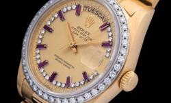 This is a truly spectacular Rolex Day-Date. At 36mm the reference 18048 is outfitted with a diamond bezel and a diamond and rubies index dial. All within an 18K yellow gold case held together by a pre