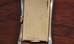 Yellow Gold Case with White Gold Trim Reference 1491 on back. Case repaired from interior side at 1 and 5 o'clock positions. Crown and Minute hand are not original. More information and Photographs ar