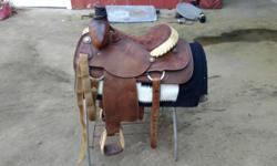 """I have two roping saddles for sale. One is a Running """"P"""" built in Muscle Shoals, AL. http://www.runningpsaddlery.com. The other is a Carl Ammerman, built in Yoakum, TX. Both of these beautifully tooled, handmade saddles are in great shape and were cleaned"""