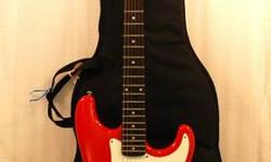 This listing is for a Samick Red Strat Style Electric Guitar with Gig Bag.  This Electric Guitar is in great condition, easy to play and sounds great.  Ohio Loan Co., Inc. 3028 Salem Avenue Dayton, Oh