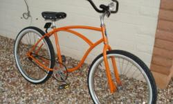 completely redone 1995 Schwinn single speed,coaster brake, 26 inch mans bike, orange metallic paint, clear coated, new decals, good tires tubes, real cool frt lite for nite riding. call my cell for mo
