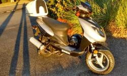 SCOOTER Znen Motorino Supremo 150cc, in near mint condition, with papers, and dealers warranty still available. 150cc, spare helmets (2), lock, and misc spares. Located in St Simmons Island