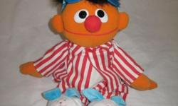 "Sing & Snore Ernie is a Sesame Street plush toy released by Tyco in 1997. The Ernie doll wears pajamas, talks when you press his hand and when he sits up, sings ""Twinkle Twinkle Little Star"", makes sn"