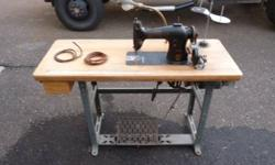 Very nice industrial singer sewing machine #95-80 see pictures Has butcher block table has lots of extra parts see pictures has thread holders but they are not mounted on the table see pictures Has so