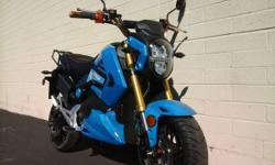 Sky Hawk looks runs just like the Honda Grom 45 MPH 42 Miles Per Charged . 2000 Watt Motorcycle 1 Year Warranty call 800 578 8608 open Monday 10AM 6PM Sat 10am 4pm closed Sunday Financing O.A.C as low