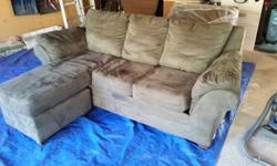 Offering a sofa bed with matching chair. Both are a deep green micro-fiber. Both in excellent shape. When we purchased them a few years ago, my wife and I paid around $850 for the pair. Both are treat