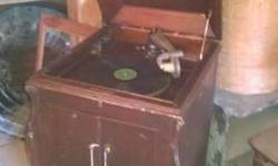 Small collection of windup Record Players, All brands some need repair most will work now $1800.00 buys all priced from $350.00 down to $50.00 for ones that need parts or repairs, vinyl records, music