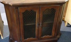 Real nice small Curio or display cabinet Has wire mesh door front Great shape Very rare piece of furniture Please either call or text us at 727-542-4615 or 813-447-8023. Please email us if you have an
