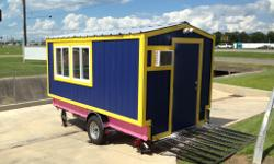 Never used snow cone trailer; brand new!! Turn key business (comes with everything you need to start a snow cone business). The stand is seven by fourteen feet; it is built on top of a five by fifteen