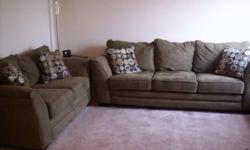 Type: Living RoomType: Sets This is a couch, love seat, and ottoman collection that is a neutral dark green color. Just 4 years of ages and in excellent condition. No busted springs or frame. It comes