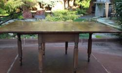 When fully extended, this antique drop leaf table is 66  long by 43  deep by 29  tall from floor to top and 23  from floor to apron. It folds down to 25  long by 43  deep. Weighs approximately 70 lbs.