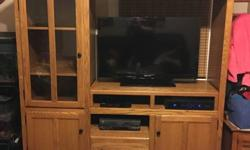 MUST GO RIGHT AWAY! Christmas stockings will look great hung from this! BEST OFFER! Solid wood entertainment center. Bought at an Amish store in Iowa and moved it here with me. Paid over $1500 origina