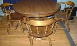 Oak wood table with laminated top. It is heavy and in very great condition.  It includes 4 initial chairs.  The dimension is 42 inches and each leaf is 15 inches.  The table with one leaf is 57 inches