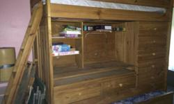 I have a strong wood bunk bed with developed in desk. The leading bunk has a ladder for gain access to and the bottom bunk is a trundle under. This is a really great unit, paid over $1000.00 new. Very