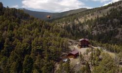 "8"" thick solid log walls, walnut floors, and R56 insulation add physical beauty and aesthetic warmth to this 2,124 sq ft; 2 story, 3 bedroom, 2 bath mountain retreat nestled on 320 acres of the sweepi"