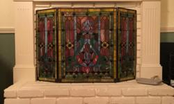 Gorgeous, vibrant stained glass fireplace screen with rich colors. Incredible artistic display, especially with fire or candlelight behind it. A rich piece of artwork even on a summer day. Cathederal-